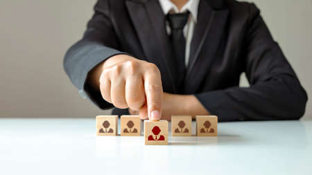 Businessmen choose wooden blocks that show outstanding people from the crowd. Or as a successful team leader HR and CEO