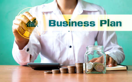 Businessman choosing growing graph icon and business plan text. Business planning ideas and strategies for business growth.