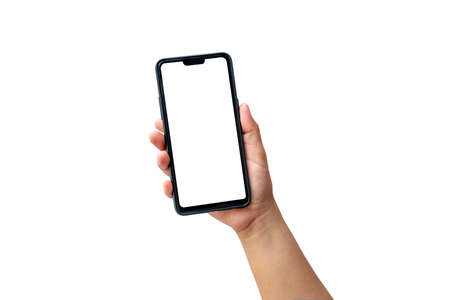 The hand is holding the white screen, the mobile phone is isolated on a white background with the clipping path. Zdjęcie Seryjne