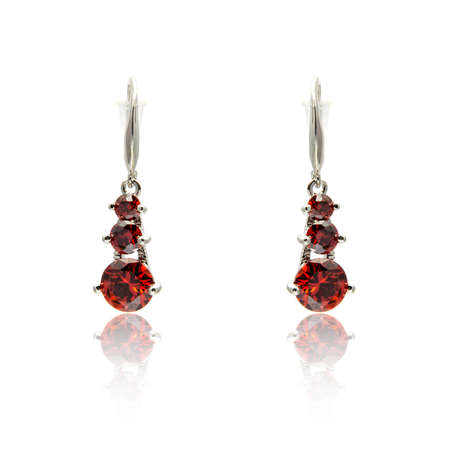 Pair of ruby diamond earrings isolated on white background