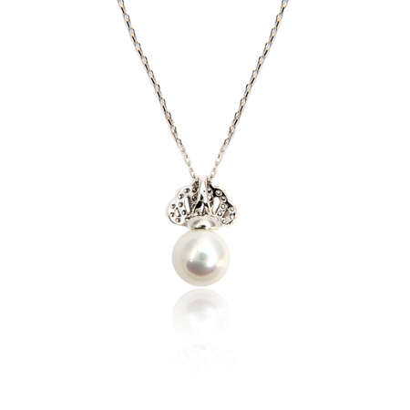 Diamond pendant with pearl isolated on white background