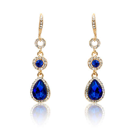 Pair of sapphire earrings isolated on white background