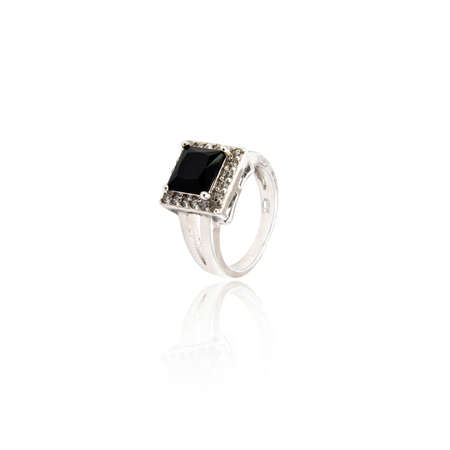 caras emociones: Black spinel diamond ring isolated on white background