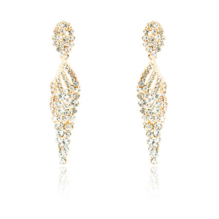 Pair of golden diamond earrings isolated on white background Stock Photo