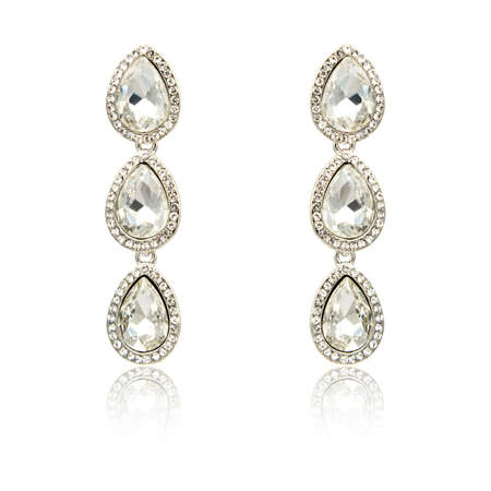 crystal background: Pair of silver diamond earrings isolated on white background Stock Photo