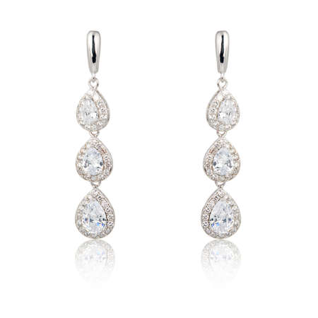 Pair of diamond earrings isolated on white background
