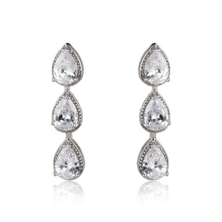 Pair of silver diamond earrings isolated on white background Reklamní fotografie