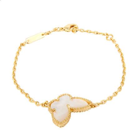 Fashion golden bracelet isolated on white background