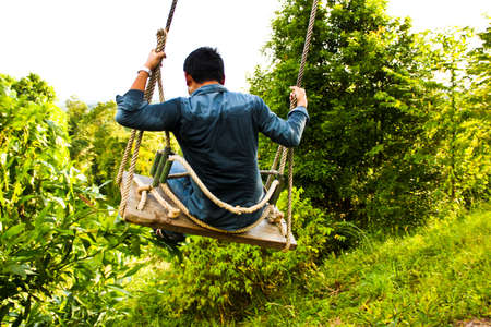 A man playing the swings. photo