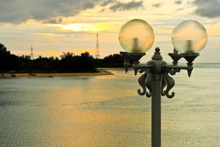 streetlamp: lamp pole beach in background