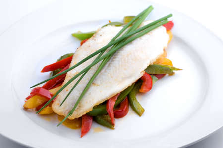 pangasius: fresh fish on vegetables