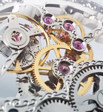 synchronously: clockwork Stock Photo