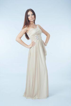 beautiful woman with modern dress posing in studio photo