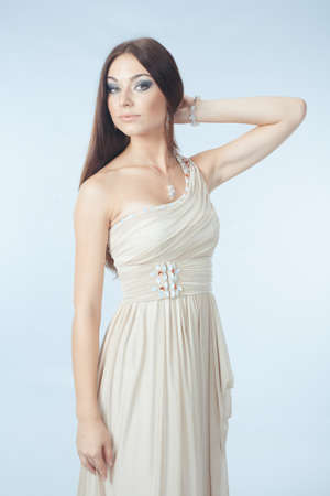 beautiful woman with modern dress posing in studio photo