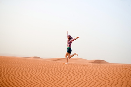 incursion: Young woman in the desert  United Arab Emirates
