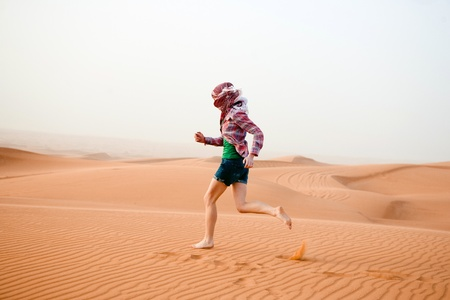 Young woman in the desert  United Arab Emirates