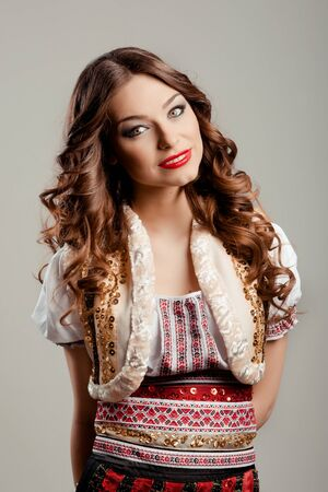 Portrait of beautiful woman posing in studio photo