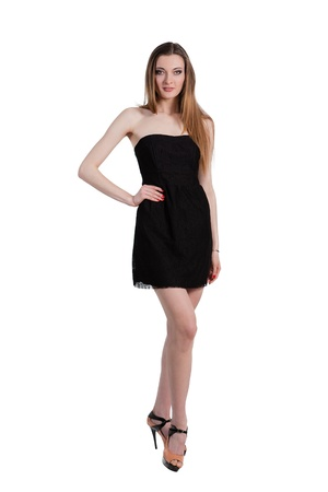 Attractive young woman in a black dress smiling and looking at camera.