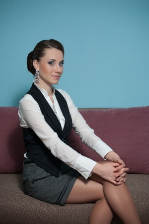 Young business woman sitting on a couch