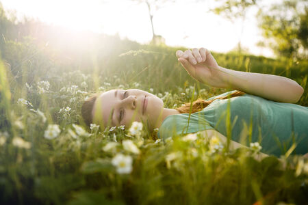 Young girl lying on the grass Stock Photo