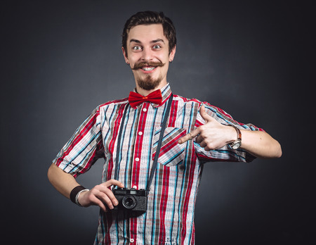 Portrait of a cheerful photographer in studio photo
