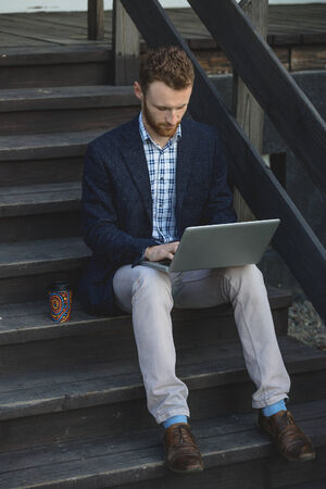 Handsome businessman working with laptop photo