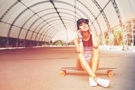 Fashion lifestyle, beautiful young woman with longboard