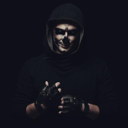 Portrait of man with Halloween skull makeup Stock Photo