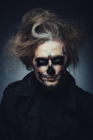 Portrait of man with Halloween skull makeup Foto de archivo