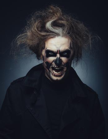 Portrait of man with Halloween skull makeup photo