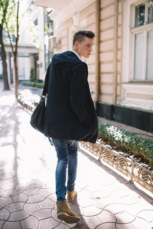 brief case: Stylish hipster model walking and holding brief case