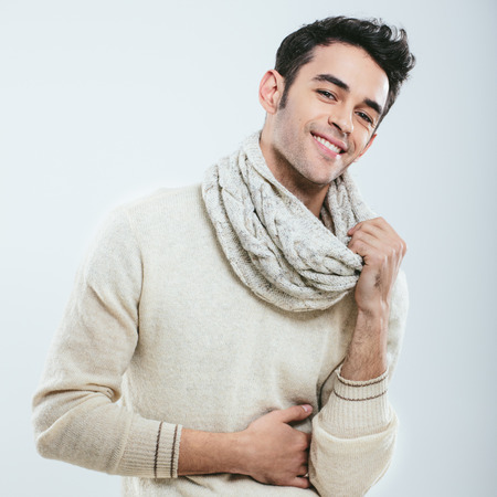 Fashionable man in winter knitted clothes. Studio portrait
