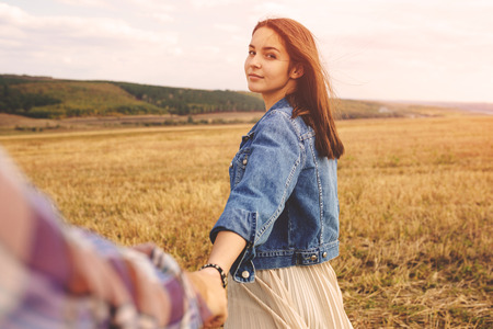 Landscape portrait of young beautiful stylish couple sensual and having fun outdoor. Film effect