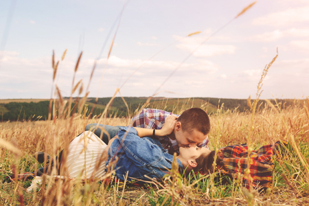 couple having fun: Landscape portrait of young beautiful stylish couple sensual and having fun outdoor. Film effect