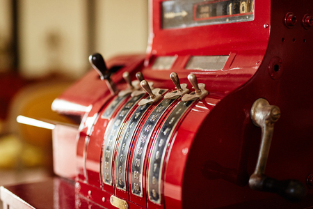 Red old-time cash register in a shop Archivio Fotografico
