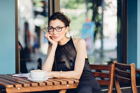 attractive girl with a notepad in the cafe Stock Photo