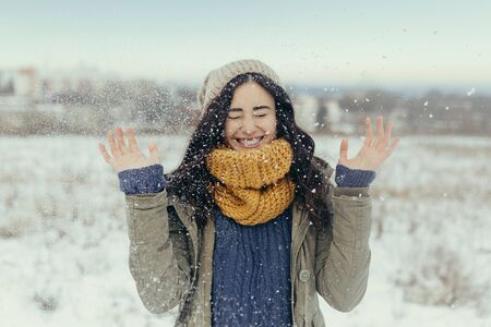 Attractive young woman having fun in wintertime outdoor
