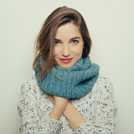 Studio portrait of an attractive young girl in winter clothes