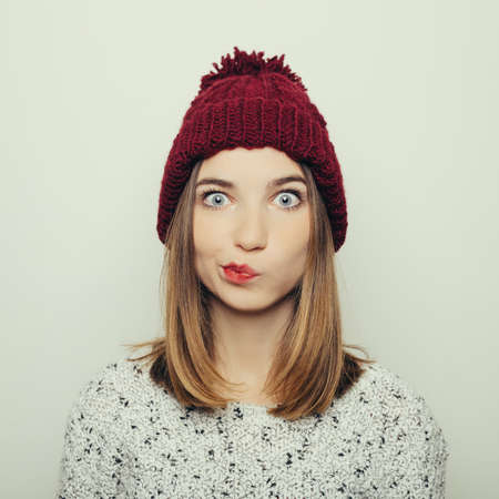 modern girls: Studio portrait of an attractive young girl in winter clothes