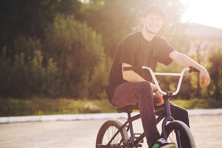 Young BMX bicycle rider having fun and posing