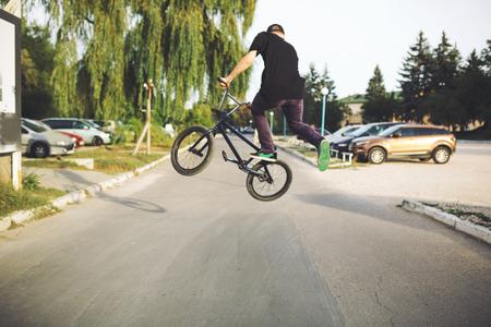 trial balance: Young BMX bicycle rider having fun and posing