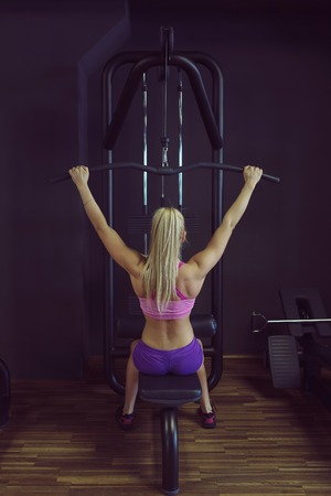 strong: Strong and beautiful athletic woman training in the gym. Strong female doing crossfit workout.