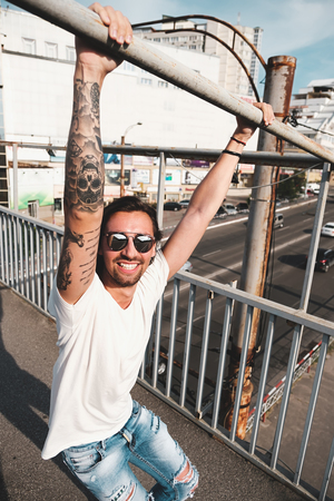Attractive man with sunglasses hanging out in the city Stock Photo