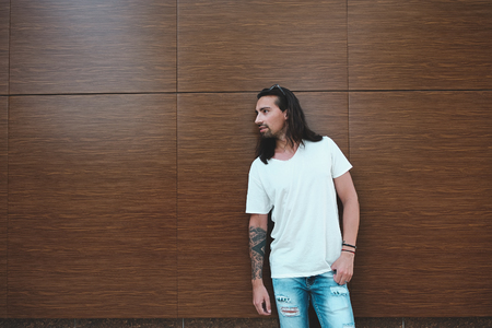 Attractive man with beard and long hair portrait Stock Photo