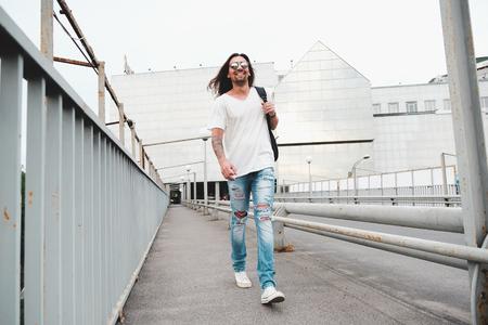 Happy man walking in the city Stock Photo