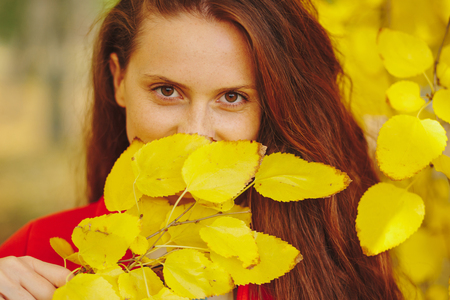 Beautiful young woman - colorful autumn portrait. Autumn Woman Fashion Portrait. Fall. Beautiful Girl. Fashion Art. Accent on eyes.