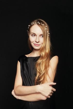Young Woman wearing a Pearl Diademe on Black Background. Natural Beauty Concept.