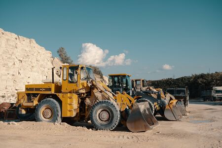 Heavy machinery in quarry. Building materials mining