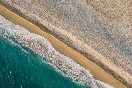 ALANYA, Antalya, Turkey. Aerial View Dunes meet Ocean Sea. A drone picture of the place where the sea meets the dunes.