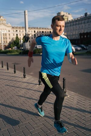 Man running in the city. Fitness workout, sport lifestyle concept.
